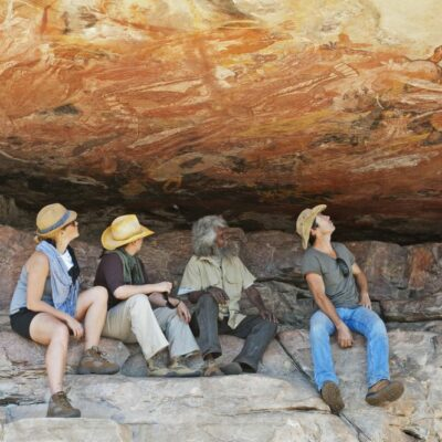 Viewing aboriginal rock art at Injalak Hill, Arnhem Land, Northern Territory, Australia