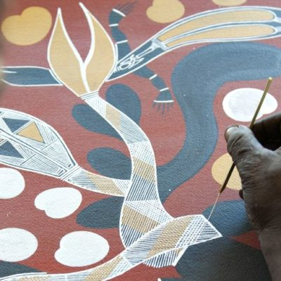 Aboriginal artist at work on a traditional painting at the Injalak Art and Craft Centre (Gunbalanya)