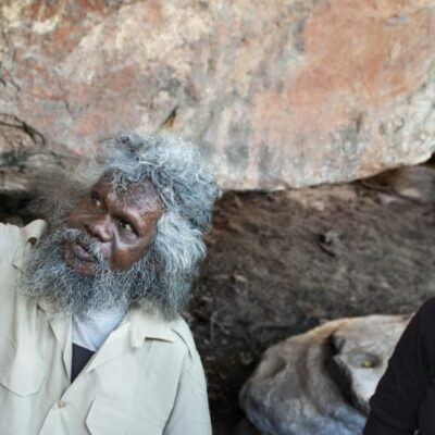 Viewing aboriginal rock art with tour guide Tommo in Arnhem Land